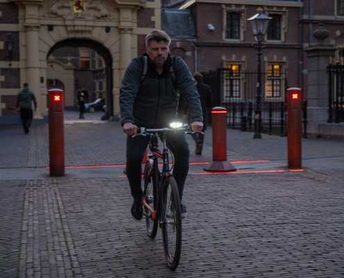 Hugo on his brik bicycle with rydon front bicyle lights in The Hague